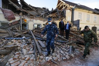 epa08909584 Croatian soldiers and officials walk through the rubble from buildings damaged in an earthquake in Petrinja, Croatia, 29 December 2020. A 6.4 magnitude earthquake struck around 3km west south west of the town with reports of many injuries and at least one death.  EPA/ANTONIO BAT