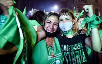 BUENOS AIRES, ARGENTINA - DECEMBER 30:  Pro-choice demonstrators celebrate after the right to an abortion is legalized on December 30, 2020 in Buenos Aires, Argentina. The proposal authorizes legal, voluntary and free interruption of pregnancy until the 14th week while allowing doctor's conscientious objection. It is the ninth bill to legalize abortion put before the Argentine Congress and the first one publicly supported by the president of the country. (Photo by Marcelo Endelli/Getty Images)
