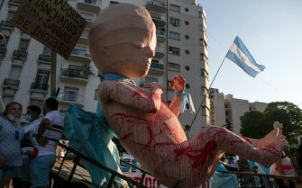 BUENOS AIRES, ARGENTINA - DECEMBER 29: A dummy of a fetus is displayed by anti abortion demonstrators outside the National Congress on December 29, 2020 in Buenos Aires, Argentina. The proposal authorizes legal, voluntary and free interruption of pregnancy until the 14th week while allowing doctor's conscientious objection. It is the ninth bill to legalize abortion treated by the Argentine Congress and the first one publicly supported by the president of the country. (Photo by Ricardo Ceppi/Getty Images)