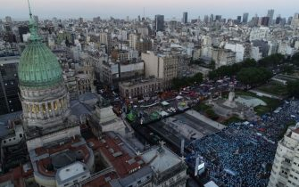 Aerial view showing anti-abortion activists (R) and abortion rights supporters (L) gathering outside the Argentine Congress as senators debate a landmark bill on whether to legalize abortion in Buenos Aires, on December 29, 2020. - Argentina's Senate on Tuesday began debating a landmark bill on whether to legalize abortion in a country where the Catholic Church has long held sway, with the vote expected to be razor-thin. (Photo by Emiliano Lasalvia / AFP) (Photo by EMILIANO LASALVIA/AFP via Getty Images)