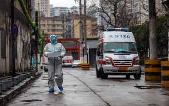 epa08168541 A fully protected ambulance driver takes a box of medical supplies to the hospital in Wuhan, Hubei province, China, 26 January 2020 (issued 27 January 2020). According to media reports, Wuhan is widely considered as the origin point of the coronavirus outbreak. The virus outbreak has so far killed at least 56 people with around 2,000 infected, mostly in China.  EPA/YUAN ZHENG CHINA OUT