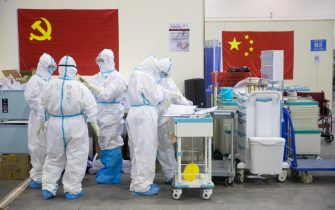 epa08224971 Medical staff in protective suits work at Wuhan Fang Cang makeshift hospital in Wuhan, Hubei Province, China, 17 February 2020 (issued 18 February 2020). The disease caused by the novel coronavirus (SARS-CoV-2) has been officially named COVID-19 by the World Health Organization (WHO). The outbreak, which originated in the Chinese city of Wuhan, has so far killed more than 1,800 people with over 73,000 infected worldwide, mostly in China.  EPA/STRINGER CHINA OUT