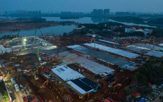epa08175302 A general aerial view of the construction site of the 1,000-bed Huoshenshan temporary hospital for 2019-nCoV (coronavirus) patients in Wuhan, central China's Hubei province in China, 28 January 2020 (Issued on 29 January 2020). The hospital is scheduled to be completed in 10 days, to be manned by doctors and nurses coming from around China. According to media reports, Chinese authorities have urged people to stop travelling in and out of Wuhan, the city at the center of the new virus outbreak that has so far killed at least 106 people and infected over four thousand others around the globe, mostly in China.  EPA/SHI YI CHINA OUT