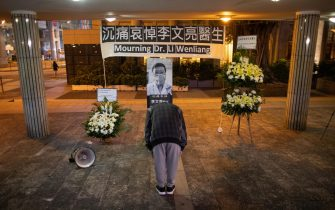 epa08200081 A mourner pays respect to Chinese doctor Li Wenliang during a mourning ceremony in Hong Kong, China, 07 February 2020. Mainland health officials have confirmed the death of Li, who was one of the first to raise concerns about the coronavirus outbreak in Wuhan, before contracting the infection himself. Li was silenced by police after trying weeks ago to raise the alarm about the new coronavirus.  EPA/JEROME FAVRE