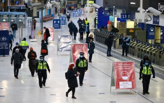Police officers patrol on the concourse at London Waterloo railway station in London, U.K., on Tuesday, Jan. 5, 2021. U.K. Prime Minister Boris Johnson pinned his hopes for a national recovery on a plan to deliver 2 million coronavirus vaccinations a week, as the U.K. went back into lockdown in an attempt to prevent hospitals being overwhelmed. Photographer: Hollie Adams/Bloomberg