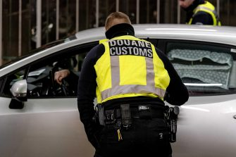 epa08924790 Dutch customs personnel checks vehicles coming off the ferry from the United Kingdom as they arrive EU territory in Hoek van Holland, the Netherlands, 06 January 2021 (issued 07 January 2021). Since the Brexit, the UK's leave from the European Union on 01 January, new rules apply for UK residents regarding the import and export of products from the UK into the EU and vice versa.  EPA/SANDER KONING