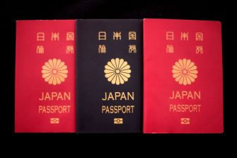 This photo illustration taken on December 19, 2018 shows covers of Japan passports in Tokyo. - Japan is one of around 50 countries in the world that allows only one nationality. (Photo by Behrouz MEHRI / AFP) / TO GO WITH Japan-nationality-politics, FOCUS by Oceane CORNEVIN        (Photo credit should read BEHROUZ MEHRI/AFP via Getty Images)
