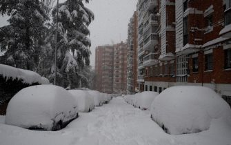epa08927583 A snow-covered street in Madrid, Spain, 09 January 2020. Storm Filomena brought the heaviest snowfall in decades.  EPA/BALLESTEROS