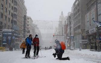epa08927719 People ski down Gran Via Avenue in Madrid, Spain, 09 January 2021. Storm Filomena brought the heaviest snowfall in decades.  EPA/BALLESTEROS