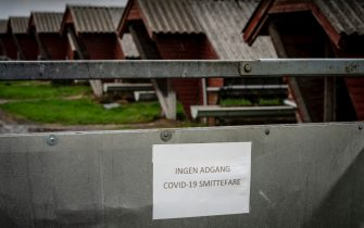 epa08798610 A sign reading 'No access Covid-19 risk of infection' at a Mink farm in Hjoerring in North Jutland, Denmark, 08 October 2020 (issued 04 November 2020). Reports on 04 November 2020 state that Denmark plans to cull all minks in the country's mink fur farms to contain a spread of a coronavirus mutation. A Covid-19 outbreak in mink farms in October 2020 saw similar measures.  EPA/Mads Claus Rasmussen  DENMARK OUT