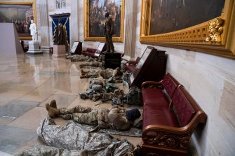 epa08935081 US National Guard troops rest in the Capitol Rotunda on Capitol Hill in Washington, DC, USA, 13 January 2021. At least ten thousand troops of the National Guard will be deployed in Washington by the end of the week, with the possibility of five thousand more, to help secure the Capitol area ahead of more potentially violent unrest in the days leading up to the Inauguration of US President-elect Joe Biden. Democrats are attempting to impeach US President Donald J. Trump after he incited a mob of his supporters to riot on the US Capitol in an attempt to thwart Congress from certifying Biden's election victory.  EPA/MICHAEL REYNOLDS