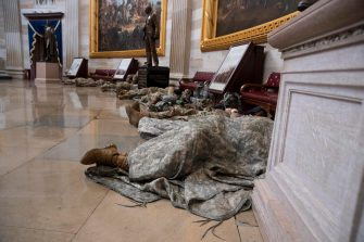 epa08935075 US National Guard troops rest in the Capitol Rotunda on Capitol Hill in Washington, DC, USA, 13 January 2021. At least ten thousand troops of the National Guard will be deployed in Washington by the end of the week, with the possibility of five thousand more, to help secure the Capitol area ahead of more potentially violent unrest in the days leading up to the Inauguration of US President-elect Joe Biden. Democrats are attempting to impeach US President Donald J. Trump after he incited a mob of his supporters to riot on the US Capitol in an attempt to thwart Congress from certifying Biden's election victory.  EPA/MICHAEL REYNOLDS