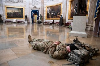 epa08935079 US National Guard troops rest in the Capitol Rotunda on Capitol Hill in Washington, DC, USA, 13 January 2021. At least ten thousand troops of the National Guard will be deployed in Washington by the end of the week, with the possibility of five thousand more, to help secure the Capitol area ahead of more potentially violent unrest in the days leading up to the Inauguration of US President-elect Joe Biden. Democrats are attempting to impeach US President Donald J. Trump after he incited a mob of his supporters to riot on the US Capitol in an attempt to thwart Congress from certifying Biden's election victory.  EPA/MICHAEL REYNOLDS