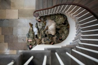 epa08935099 Members of the National Guard try to get some sleep inside the US Capitol in Washington, DC, USA, 13 January 2021. Democrats hope to impeach the president a second time for incitement of insurrection following the attack on the Capitol last week as lawmakers worked to certify Joe Biden as the next President of the United States.  EPA/JIM LO SCALZO