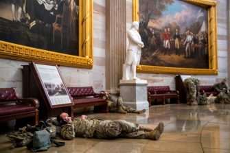 epa08935140 US National Guard soldiers taking a break inside the US Capitol in Washington, DC, USA, 13 January 2021. Today the House starts impeachment proceedings against US President Donald J. Trump for inciting the insurrection that lead to the storming of the US Capitol by Trump partisans.  EPA/SHAWN THEW