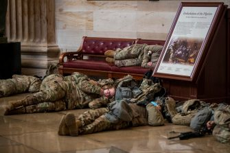 epa08935181 US National Guard soldiers taking a break inside the US Capitol in Washington, DC, USA, 13 January 2021. Today the House starts impeachment proceedings against US President Donald J. Trump for inciting the insurrection that lead to the storming of the US Capitol by Trump partisans.  EPA/SHAWN THEW