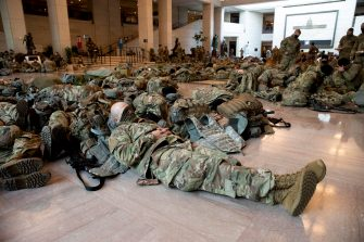 epa08935285 Hundreds of US National Guard troops rest in the Capitol Visitors Center on Capitol Hill in Washington, DC, USA, 13 January 2021. At least ten thousand troops of the National Guard will be deployed in Washington by the end of the week, with the possibility of five thousand more, to help secure the Capitol area ahead of more potentially violent unrest in the days leading up to the Inauguration of US President-elect Joe Biden. Democrats are attempting to impeach US President Donald J. Trump after he incited a mob of his supporters to riot on the US Capitol in an attempt to thwart Congress from certifying Biden's election victory.  EPA/MICHAEL REYNOLDS