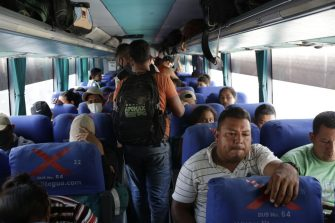 EL FLORIDO, GUATEMALA - JANUARY 18: Honduran migrants wait in buses to return to the border with their country on January 18, 2021 in El Florido, Guatemala. The caravan departed from Honduras to walk across Guatemala and Mexico to eventually reach the United States. After clashing with the police yesterday migrants are being held to carry out immigration and heath controls. Central Americans expect to receive asylum and most Hondurans decided to migrate after being hit by recent hurricanes.  (Photo by Josue Decavele/Getty Images)