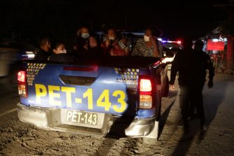 RIO HONDO, GUATEMALA - JANUARY 18: An Honduran migrant family is taken to a Red Cross tent by a police unit on January 18, 2021 in Rio Hondo, Zacapa, Guatemala. The caravan departed from Honduras to walk across Guatemala and Mexico to eventually reach the United States. After clashing with the police yesterday migrants are being held to carry out immigration and heath controls. Central Americans expect to receive asylum and most Hondurans decided to migrate after being hit by recent hurricanes.  (Photo by Getty Images/Getty Images)