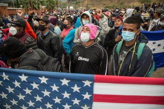 epaselect epa08947057 Thousands of migrants block the road in Vado Hondo, Chiquimula, Guatemala, 18 January 2021. The Guatemalan security forces forcibly dissolved a migrant caravan of more than 6,000 Hondurans seeking to reach the United States.  EPA/Esteban Biba