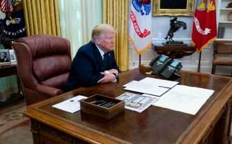 epa08450843 US President Donald J. Trump makes remarks before signing an executive order on social media that will punish Facebook, Google and Twitter for the way they police content online,  in the Oval Office, White House, Washington, DC, USA, 28 May 2020.  EPA/DOUG MILLS/ POOL