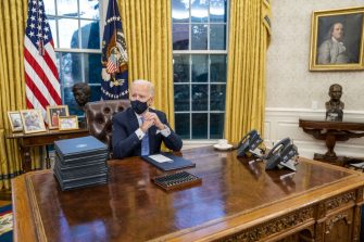 """U.S. President Joe Biden prepares to sign executive orders in the Oval Office of the White House in Washington, D.C., U.S., on Wednesday, Jan. 20, 2021. Biden began his presidency with a soaring appeal to end Americas """"uncivil war"""" and reset the tone in Washington, delivering an inaugural address that dispensed with a laundry list of policy goals to instead confront the nation's glaring political divides as the foremost obstacle to moving the country forward. Photographer: Doug Mills/The New York Times/Bloomberg via Getty Images"""