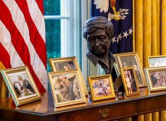 WASHINGTON, DC - January 20:  A sculpted bust of Cesar Chavez oversees a collection of personal framed photos on a table seen during an early preview of the redesigned Oval Office awaiting President Joseph Biden at the White House in Washington, DC. (Photo by Bill O'Leary/The Washington Post via Getty Images)