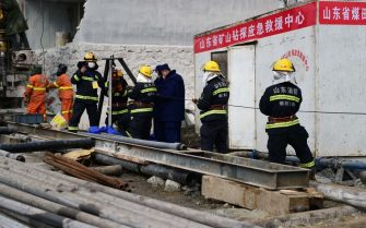 QIXIA, CHINA - JANUARY 20: Rescuers work at the explosion site of a gold mine on January 20, 2021 in Qixia, Shandong Province of China. A life-saving passage into a collapsed gold mine is under construction in Qixia under Yantai City. Rescuers have established contact with some of the 22 miners that got trapped underground following an explosion on Jan. 10. Eleven of the miners were found Sunday through a drilled channel. A total 589 personnel from 16 professional rescue teams and one fire team have been working around the clock. The physical condition of the eight trapped miners have improved after they received nutritious supplies, while one was in a coma and two experiencing mild discomfort. (Photo by Yang Bing/China News Service via Getty Images)