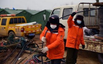 This photo taken on January 20, 2021 shows members of a rescue team working at the site of a gold mine explosion where 22 miners are trapped underground in Qixia, in eastern China's Shandong province. (Photo by STR / various sources / AFP) / China OUT (Photo by STR/AFP via Getty Images)