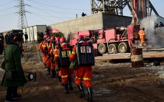 This photo taken on January 13, 2021 shows rescuers working at the site of gold mine explosion where 22 miners were trapped underground in Qixia, in eastern China's Shandong province. - Miners trapped underground in eastern China for more than a week after a blast at a gold mine have managed to send up a note to rescuers, the local government said on January 18. (Photo by STR / various sources / AFP) / China OUT (Photo by STR/AFP via Getty Images)
