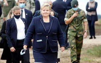 epa08654025 Norway's Prime Minister Erna Solberg during her visit to Pabdrade Military base in Lithuania, 08 September 2020. Erna Solberg is on a one day visit to Lithuania.  EPA/Valda Kalnina