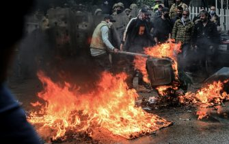 28 January 2021, Lebanon, Tripoli: Anti-government activists burn tyres and garbage in front of Serail (headquarters of the Governorate) during a protest against the bad economical situations that the country facing amid a national coronavirus lockdown to curb the spread of the coronavirus pandemic. A man lost his life and at least 200 people got injured in the past couple of days due to the ongoing demonstrations. Photo: Marwan Naamani/dpa