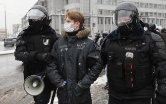 epa08976821 Russian police officers detain protester during an unauthorized protest in support of Russian opposition leader Alexei Navalny, Moscow, Russia, 31 January 2021. Navalny was detained after his arrival to Moscow from Germany, where he was recovering from a poisoning attack with a nerve agent, on 17 January 2021. A Moscow judge on 18 January ruled that he will remain in custody for 30 days following his airport arrest. Navalny urged Russians to take to the streets to protest. In many Russian cities mass events are prohibited due to an increase in COVID-19 cases.  EPA/YURI KOCHETKOV
