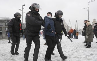 epa08976746 Russian police officers detains protester during an unauthorized protest in support of Russian opposition leader Alexei Navalny, Moscow, Russia, 31 January 2021. Navalny was detained after his arrival to Moscow from Germany on 17 January 2021. A Moscow judge on 18 January ruled that he will remain in custody for 30 days following his airport arrest. Navalny urged Russians to take to the streets to protest. In many Russian cities mass events are prohibited due to an increase in COVID-19 cases.  EPA/SERGEI ILNITSKY