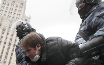 epa08976820 Russian police officers detain protester during an unauthorized protest in support of Russian opposition leader Alexei Navalny, Moscow, Russia, 31 January 2021. Navalny was detained after his arrival to Moscow from Germany, where he was recovering from a poisoning attack with a nerve agent, on 17 January 2021. A Moscow judge on 18 January ruled that he will remain in custody for 30 days following his airport arrest. Navalny urged Russians to take to the streets to protest. In many Russian cities mass events are prohibited due to an increase in COVID-19 cases.  EPA/YURI KOCHETKOV