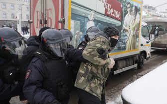 epa08976745 Russian police officers detains protester during an unauthorized protest in support of Russian opposition leader Alexei Navalny, Moscow, Russia, 31 January 2021. Navalny was detained after his arrival to Moscow from Germany on 17 January 2021. A Moscow judge on 18 January ruled that he will remain in custody for 30 days following his airport arrest. Navalny urged Russians to take to the streets to protest. In many Russian cities mass events are prohibited due to an increase in COVID-19 cases.  EPA/SERGEI ILNITSKY