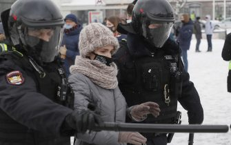 epa08976742 Russian police officers detains protester during an unauthorized protest in support of Russian opposition leader Alexei Navalny, Moscow, Russia, 31 January 2021. Navalny was detained after his arrival to Moscow from Germany on 17 January 2021. A Moscow judge on 18 January ruled that he will remain in custody for 30 days following his airport arrest. Navalny urged Russians to take to the streets to protest. In many Russian cities mass events are prohibited due to an increase in COVID-19 cases.  EPA/SERGEI ILNITSKY