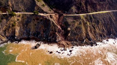 Construction crews work on a section of Highway 1 which collapsed into the Pacific Ocean near Big Sur, California on January 31, 2021. - Heavy rains caused debris flows of trees, boulders and mud that washed out a 150-foot section of the road. (Photo by JOSH EDELSON / AFP) (Photo by JOSH EDELSON/AFP via Getty Images)