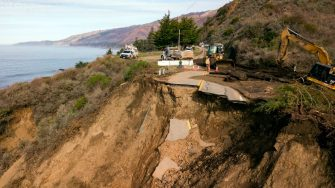 Construction crews work at the scene where a section of Highway 1 collapsed into the Pacific Ocean near Big Sur, California on January 31, 2021. - Heavy rains caused debris flows of trees, boulders and mud that washed out a 150-foot section of the road. (Photo by JOSH EDELSON / AFP) (Photo by JOSH EDELSON/AFP via Getty Images)