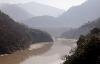 epa08995389 View of the overflowed Mandakini river, a tributary of the Alaknanda River, near the Rudraprayag district in Uttarakhand, India, 08 February 2021. At least 11 people died and nearly 150 are still missing after part of the Nanda Devi glacier fell into the river, triggering a flood that burst open a dam in the Tapovan area of Uttarakhand's Chamoli district on 07 February 2021.  EPA/RAJAT GUPTA