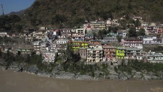 epa08995392 View of the overflowed Mandakini river, a tributary of the Alaknanda River, near the Rudraprayag district in Uttarakhand, India, 08 February 2021. At least 11 people died and nearly 150 are still missing after part of the Nanda Devi glacier fell into the river, triggering a flood that burst open a dam in the Tapovan area of Uttarakhand's Chamoli district on 07 February 2021.  EPA/RAJAT GUPTA