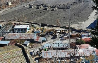 epa08993671 A general view of an area near the Dhauliganga hydro power project after a portion of Nanda Devi glacier broke off, at Reni village in Chamoli district, Uttrakhand, India 07 February 2021. Over 100 people are feared dead after part of the Nanda Devi glacier broke off causing massive floods in the Tapovan area of Uttarakhand's Chamoli district.  EPA/ARVIND MOUDGIL -- BEST QUALITY AVAILABLE --