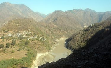 epa08995386 View of the overflowed Mandakini river, a tributary of the Alaknanda River, near the Rudraprayag district in Uttarakhand, India, 08 February 2021. At least 11 people died and nearly 150 are still missing after part of the Nanda Devi glacier fell into the river, triggering a flood that burst open a dam in the Tapovan area of Uttarakhand's Chamoli district on 07 February 2021.  EPA/RAJAT GUPTA