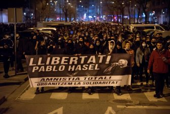 epa09020409 Protesters hold a banner reading 'Free Pablo Hasel. Total Amnesty. Let's organize solidarity' during a protest to condemn the imprisonment of Spanish rapper Pau Rivadulla Duro A.K.A 'Pablo Hasel', in Barcelona, Spain, 17 February 2021. Hasel was given a nine-month-prison sentence late January after the Supreme Court found him guilty of incitement to terrorism and offense against the dignity of the Spanish Crown and State institutions on his lyrics.  EPA/Ramon Gabriel