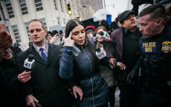 epa09030501 (FILE) - Emma Coronel Aispuro (C) leaves the building after a verdict was reached in the trial of her husband Joaquin 'El Chapo' Guzman at United States Federal Court in Brooklyn, New York, USA, 12 February 2019 (Reissued 22 February 2021). Emma Coronel Aispuro, wife of drug lord Joaquin 'El Chapo' Guzman, was arrested in relation to her alleged role in the trafficking and distribution of drugs in the US.  EPA/KEVIN HAGEN *** Local Caption *** 54980315