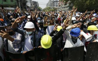 epa09041881 Demonstrators flash the three-finger salute  during a protest against the military coup in Yangon, Myanmar, 28 February 2021. Security forces intensified their use of force to crack down on anti-coup demonstrations following weeks of unrest since the 01 February military coup.  EPA/LYNN BO BO