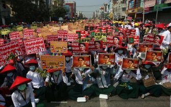 epa09041834 Demonstrators hold placards calling for the released of detained civilian leader Aung San Suu Kyi during a protest against the military coup in Mandalay, Myanmar, 28 February 2021. Security forces intensified their use of force to crack down on anti-coup demonstrations following weeks of unrest since the 01 February military coup.  EPA/KAUNG ZAW HEIN