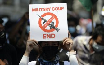 epa09041767 A demonstrator holds a placard during a protest against the military coup, in Yangon, Myanmar, 28 February 2021. Security forces intensified their use of force to crack down on anti-coup demonstrations following weeks of unrest since the 01 February military coup.  EPA/LYNN BO BO