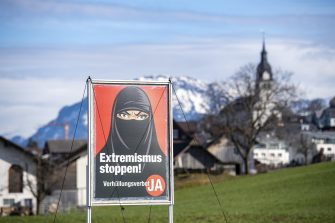 epa09056929 (FILE) - A poster of the initiative 'Yes to the burqa-ban' is seen in Oberdorf, in the canton of Nidwalden, Switzerland, 16 February 2021 (reissued 06 March 2021). Swiss citizens are called on Sunday 7 March to vote on a proposal to prohibit the concealment of one's face in the public space. Led by right-wing groups, the so-called 'anti-burqa' initiative provides for a ban on the wearing of the niqab, as well as other non-religious forms of face concealment.  EPA/URS FLUEELER