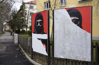epa09056966 (FILE) - A torn poster of the initiative 'Yes to the burqa-ban' is seen in Bern, Switzerland, 04 February 2021 (reissued 06 March 2021). Swiss citizens are called on Sunday 7 March to vote on a proposal to prohibit the concealment of one's face in the public space. Led by right-wing groups, the so-called 'anti-burqa' initiative provides for a ban on the wearing of the niqab, as well as other non-religious forms of face concealment.  EPA/PETER KLAUNZER